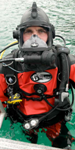 Aqua Lung Public Safety and Military Equipment | Pro Ops | Diver pictured wearing: Apeks Guardian Full Face Mask, Apeks Regulator and Gauge Console, BC1, Rocket II Fins, Whites Hazmat Public Safety Drysuit,...