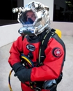 "Aqua Lung Hazmat Commercial Drysuit | Commercial diver shown with Gorski G2000SS helmet | The innovative and field-proven Gorski G2000SS helmet sets the standard for modern diving helmets. A game-changer in terms of materials, build quality, robustness and user-maintainability. | The Aqua Lung Group is committed to providing robust, reliable and high performance equipment to all parts of the Military & Professional diving community. Their clear goal is to be the premier ""One Stop"" provider of professional grade diving equipment to the commercial diving industry. 