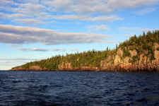 Isle Royale National Park | This wilderness archipelago is 45 miles long and nine miles wide at its widest point. Isle Royale National Park encompasses a total area of 850 square miles including submerged lands which extends four and a half miles out into Lake Superior. The archipelago is composed of many parallel ridges resulting from ancient lava flows which were tilted and glaciated. Isle Royale has 165 miles of scenic hiking trails and 36 campgrounds for backpackers and recreational boaters. There is excellent fishing, historic lighthouses and shipwrecks, ancient copper mining sites, and plenty of spots to observe wildlife. | Photo: James McKay, Scuba Center